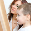 Woman and little boy drawing on board — Stock Photo