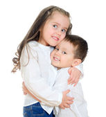 Little girl and boy hugging. Isolated on white — Stock Photo