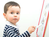 Little boy drawing on whiteboard. — Stock Photo
