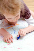 Cute little girl drawing with pencil — Stock Photo