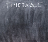 Word timetable written with chalk on blackboard — Stock Photo