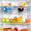 Open fridge full of fruits, vegetables and meat — Stock Photo