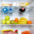 Stock Photo: Open fridge full of fruits, vegetables and meat