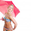 Blonde girl with vintage spotted umbrella in striped bikini over white background — Stock Photo #21301931