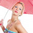 Blonde girl with vintage spotted umbrella in striped bikini over white background — Stock Photo
