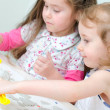 Stock Photo: Two little girls sculpting using clay
