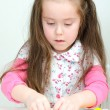 Stock Photo: Cute undistracted girl sculpting using clay