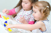 Two little girls sculpting using clay — Stock Photo