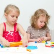 Stock Photo: Two little girls sculpting using plasticine