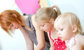 Depressed mother with her two daughters — Stock Photo