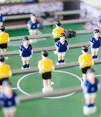 Table football game with yellow and blue players — Stock Photo