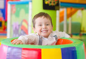 Happy little boy playing in playroom — Stock Photo