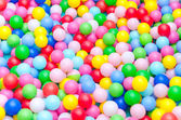 A lot of coloured plastic balls in playroom — Stock Photo