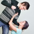 Royalty-Free Stock Photo: Man going to beat his wife. Home violence concept