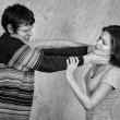 Young couple quarreling and fighting. Black and white — Stock Photo #24394593
