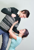 Man going to beat his wife. Home violence concept — Stock Photo