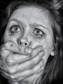 Portrait of scared woman with tears. Violence concept. Black and white — Stock Photo
