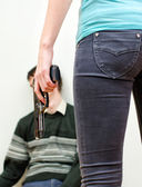 Woman killing man. Home violence concept — Stock Photo