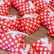 Many red gift boxes on the table — Stock Photo