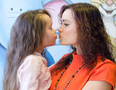 Mother and daughter kissing each other — Stock Photo