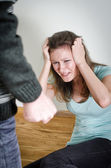 Man with knife coming to his wife. Home violence concept — Stock Photo
