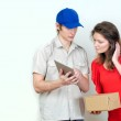 Young courier deliver package to pretty woman — Stock Photo #24489649