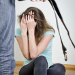 Man with belt coming to his wife. Home violence concept — Stock Photo
