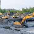 Several excavators on construction site — Stock Photo #25657505