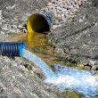 Stock Photo: Waste water pipe polluting environment