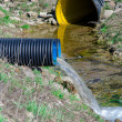 Waste water pipe polluting environment — Stock Photo