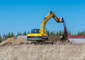 Excavator machine works at construction site — Stock Photo