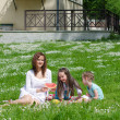 Stock Photo: Mother and children having fun on picnic in the park