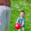 Mother and child playing with the ball outdoors — Stock Photo