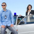 Two FBI agents near the car with flasher — Stock Photo #27344645