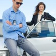 Two FBI agents near the car with flasher — Stock Photo #27344657