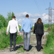 Постер, плакат: Two FBI agents conduct arrest of an offender Back view