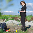 Young female criminalist inspecting crime scene — Стоковая фотография