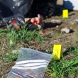 Crime scene with male corpse and evidence markers — Stock Photo