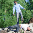 Stock Photo: Offender gets rid of corpse, throws off cliff