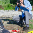 Young criminalist takes picture of crime scene — Stock Photo #27345169