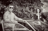 Two FBI agents near the car with flasher. Black and white — Stock Photo