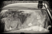 Two young detectives driving to crime scene. Black and white — Stock Photo