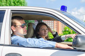 Two young detectives driving to crime scene. — Stock Photo