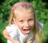 Little girl screaming at the camera — Stock Photo