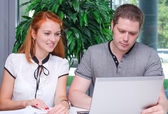 Male and female students studying using laptop — Stock Photo