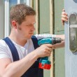 Young handsome handyman using screwdriver — Stock Photo
