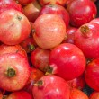 Lot of red fresh pomegranates closeup view — Stock Photo