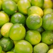 Lots of bright green limes in supermarket — Stock Photo #29849467