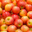 Lots of bright apples in supermarket — Stock Photo