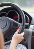 Female driver's hands on a steering wheel of a car — Stock Photo